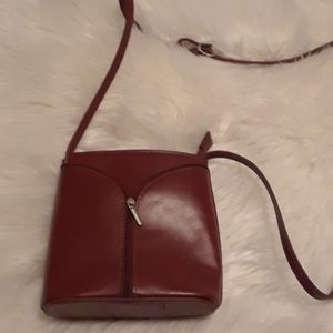 Crossbody rust colored leather purse from Italy